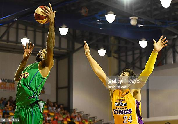 Mickell Gladness of the Crocodiles collects a re-bound in front of Cody Ellis of the Kings during the round 15 NBL match between the Townsville...