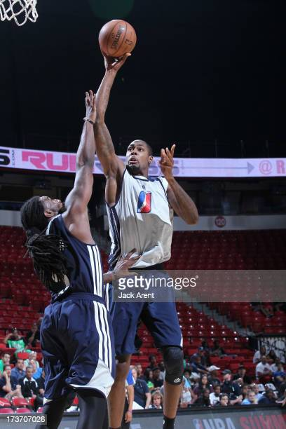 Mickell Gladness of the D-League Select Team goes to the basket against Jae Crowder of the Dallas Mavericks during NBA Summer League game between the...