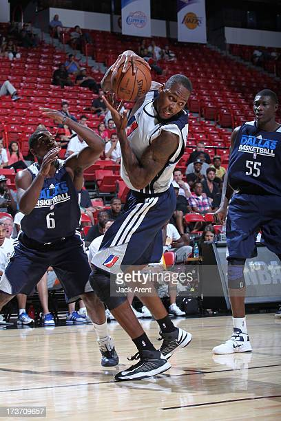 Mickell Gladness of the D-League Select Team handles the ball during NBA Summer League game between the D-League Select against the Dallas Mavericks...