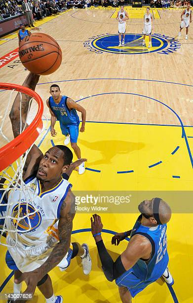 Mickell Gladness of the Golden State Warriors goes up for the dunk against the Dallas Mavericks on April 12, 2012 at Oracle Arena in Oakland,...