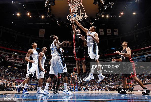 Mickell Gladness of the Miami Heat shoots the basketball against Daniel Orton of the Orlando Magic during the preseason game on December 21, 2011 at...