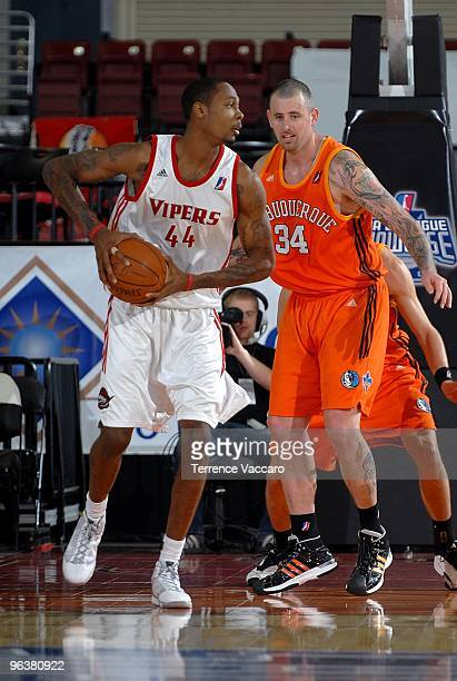 Mickell Gladness of the Rio Grande Valley Vipers drives the ball against Kevin Pittsnogle of the Albuquerque Thunderbirds during the D-League game on...