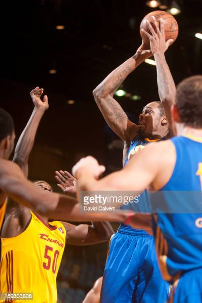 Mickell Gladness of the Santa Cruz Warrior shoots over defender Michael Eric of the Canton Charge during the 2013 NBA D-League Showcase on January...