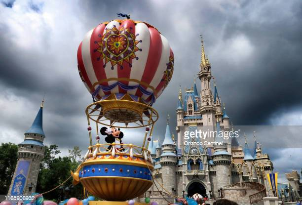 Mickey and Minnie appear under stormy skies during the afternoon parade, shortly before the Magic Kingdom at Walt Disney World in Lake Buena Vista,...