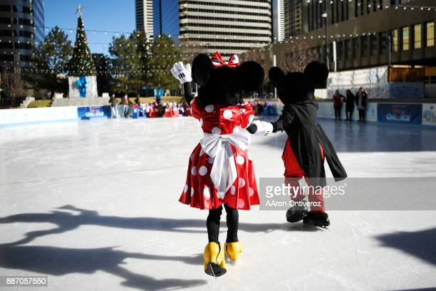 Mickey and Minnie Mouse arrive to skate with children from Warren Village Learning Center Students skated with performers from Disney on Ice at the...