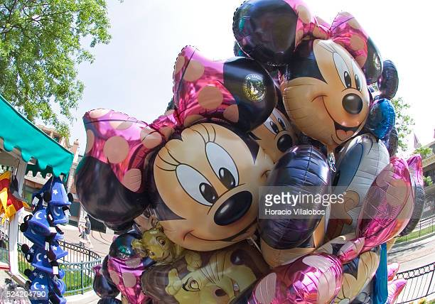 A Mickey and Minnie Mouse balloon stand waits for customers at Disneyland Paris as it opens its doors to another quiet day The company which is...