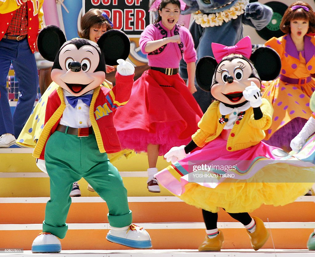 mickey and minnie mouse dance on 60s rock and roll music for the new