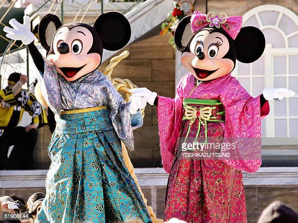 Mickey and Minnie Mouse dressed in kimonos wave to greet guests during a New Year's event at Tokyo DisneySea in Urayasu suburban Tokyo 01 January...