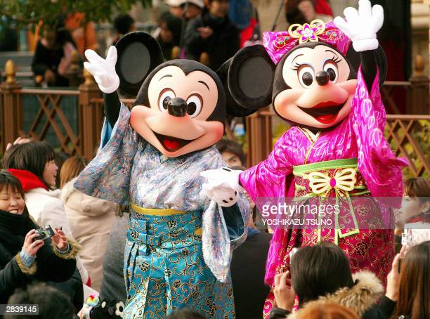 Mickey and Minnie Mouse in kimono dress wave their hands to greet guests during a New Year's event at the Tokyo DisneySea in Urayasu city suburban...