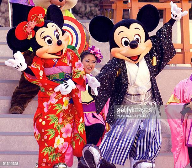 Mickey and Minnie Mouse in traditional Japanese kimonos perform for the New Year celebration at the Tokyo Dineyland 01 January 2000 Over 120000...