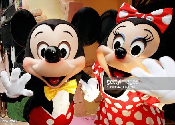MIckey and Minnie Mouse wave to celebrate the reopening of Disney Store Japanese's flagship shop at Shibuya in Tokyo 17 March 2005 Disney's retail...