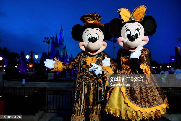 Mickey and Minnie pose with Halloween costumes during Mickey's NotSoScary Halloween Party at Magic Kingdom on August 17 2018 in Lake Buena Vista...
