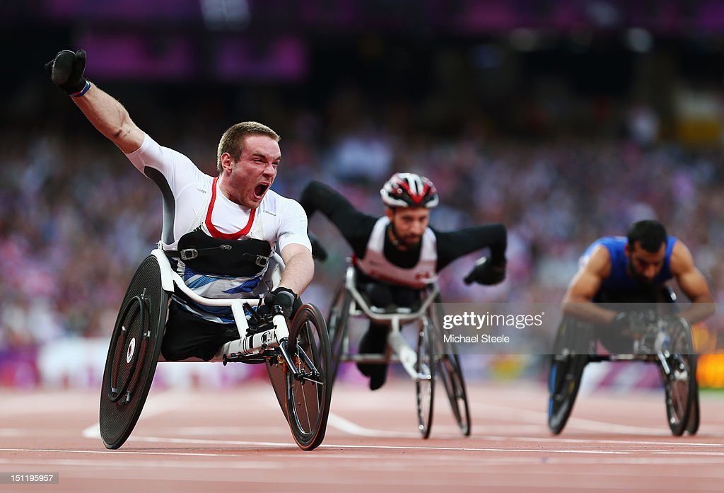 Mickey Bushell of Great Britain crosses the line to win gold in the Men's 100m - T53 Final on day 5 of the London 2012 Paralympic Games at Olympic Stadium on September 3, 2012 in London, England.