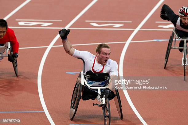 Mickey Bushell of great Britain give a fist pump at the finish of the men's 100 meters T53 final at Olympic Stadium Bushell's time was 1475 seconds...