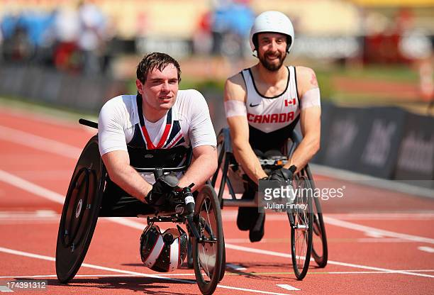 Mickey Bushell of Great Britain with Brent Lakatos of Canada after the Men's 100m T53 semi final during day six of the IPC Athletics World...