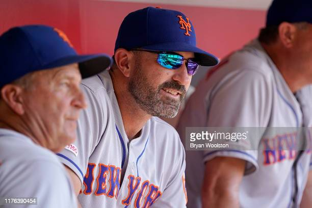 Mickey Callaway manager of the New York Mets sits in the dugout during the game against the Cincinnati Reds at Great American Ball Park on September...