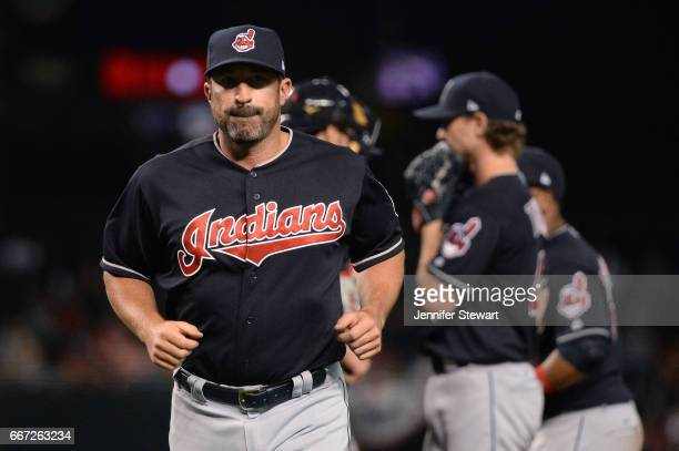 Mickey Callaway of the Cleveland Indians runs back to the dugout after talking with Josh Tomlin in the fifth inning against the Arizona Diamondbacks...