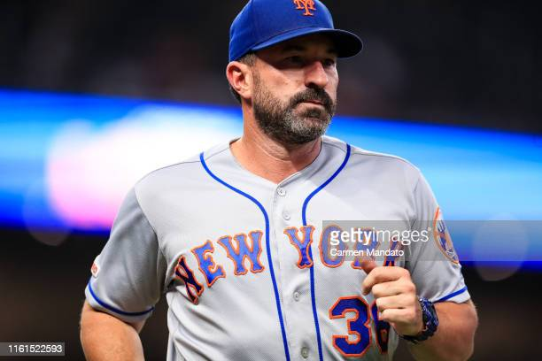 Mickey Callaway of the New York Mets heads off the field in the ninth inning during the game against the Atlanta Braves at SunTrust Park on August 13...