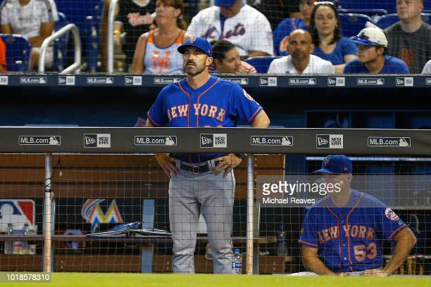 Mickey Callaway of the New York Mets looks on from the dugout against the Miami Marlins at Marlins Park on August 12 2018 in Miami Florida