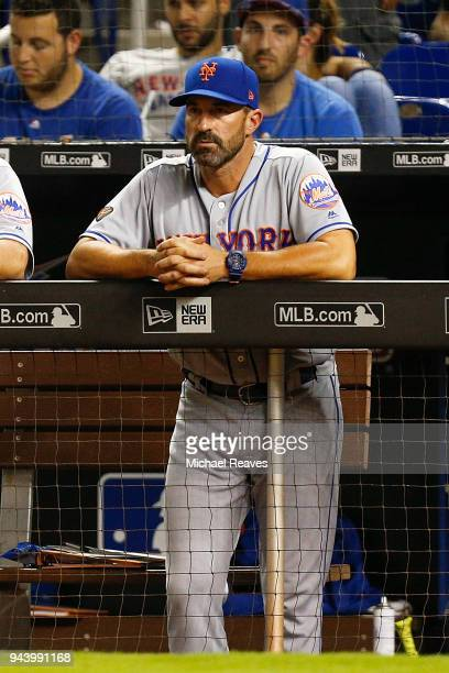 Mickey Callaway of the New York Mets looks on from the dugout against the Miami Marlins at Marlins Park on April 9 2018 in Miami Florida