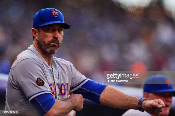 Mickey Callaway of the New York Mets looks on from the dugout in the first inning of a game against the Colorado Rockies at Coors Field on June 18...