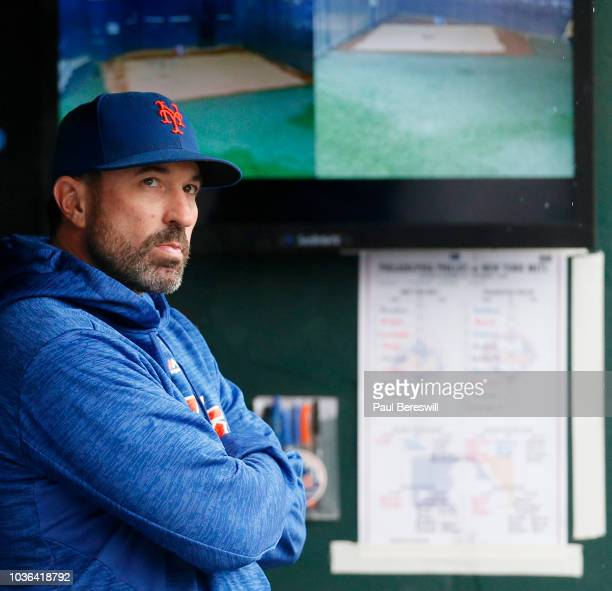 Mickey Callaway of the New York Mets looks out from the dugout at the rain prior to an MLB baseball game against the Philadelphia Phillies on...