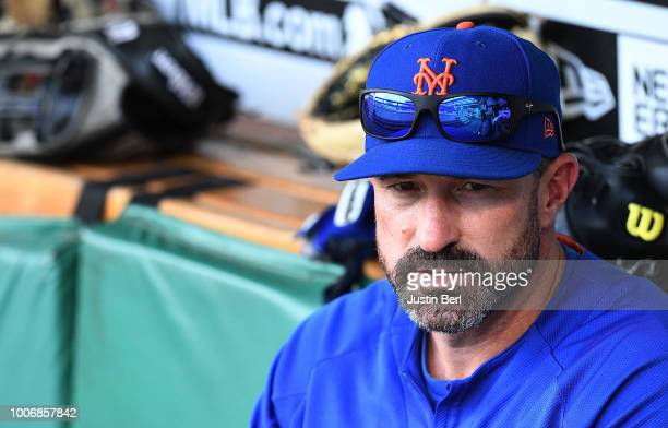 Mickey Callaway of the New York Mets sits in the dugout during batting practice before the game against the Pittsburgh Pirates at PNC Park on July 28...