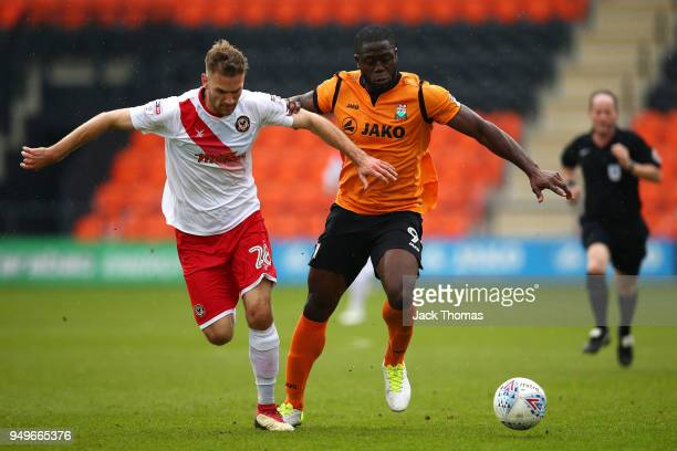 Mickey Demetriou of Newport County AFC and John Akinde of Barnet FC in action during the Sky Bet League Two match between Barnet FC and Newport...
