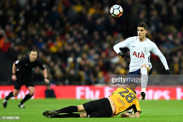 Mickey Demetriou of Newport County gets caught up with Tottenham Hotspur's Erik Lamela during the FA Cup Fourth Round replay match between Tottenham...