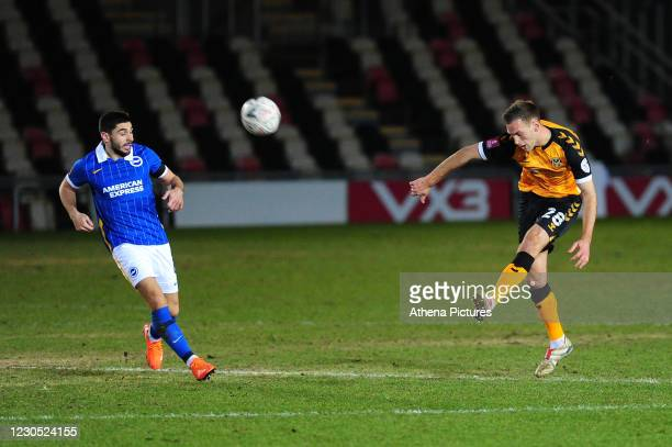 Mickey Demetriou of Newport County in action during the FA Cup Third Round match between Newport County and Brighton And Hove Albion at Rodney Parade...