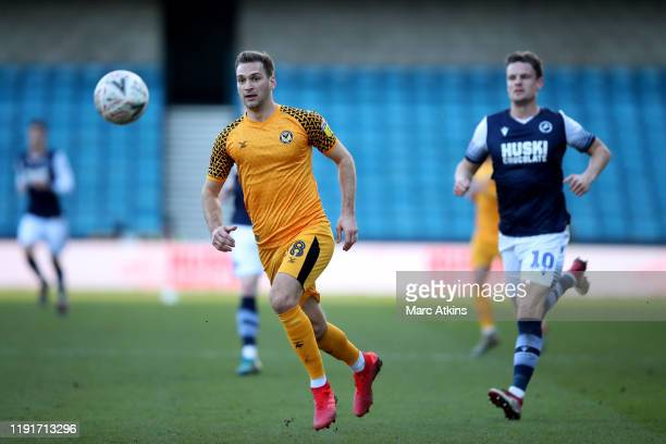 Mickey Demetriou of Newport County in action with Matt Smith of Millwall during the FA Cup Third Round match between Millwall and Newport County AFC...