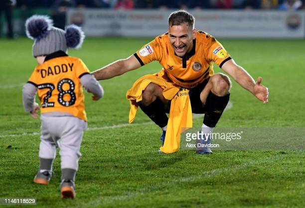 Mickey Demetriou of Newport County plays with his son after the Sky Bet League Two match between Newport County and Oldham Athletic at Rodney Parade...