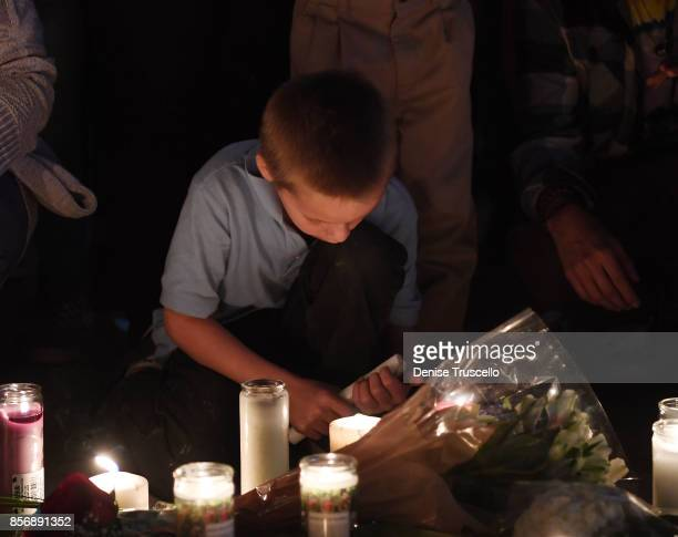 Mickey Deustch of Las Vegas, Nevada attends a vigil on the Las Vegas strip for the victims of the Route 91 Harvest country music festival shootings...