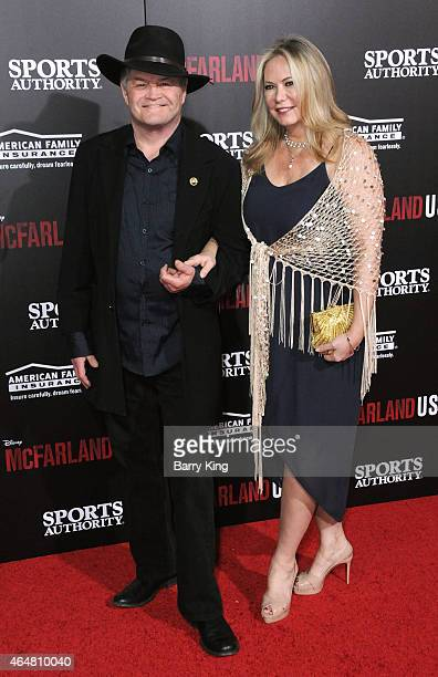 Mickey Dolenz and wife Donna Quinter arrive at the world premiere of 'McFarland USA' at the El Capitan Theatre on February 9 2015 in Hollywood...