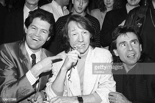 Mickey Dolenz Peter Tork and Davy Jones of The Monkees promoting their upcoming tour in London England on March 08 1989