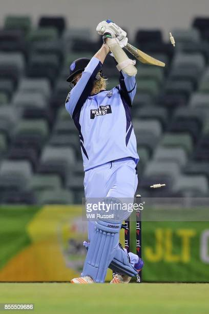 Mickey Edwards of NSW is bowled by Jason Behrendorff of WA during the JLT One Day Cup match between New South Wales and Western Australia at WACA on...