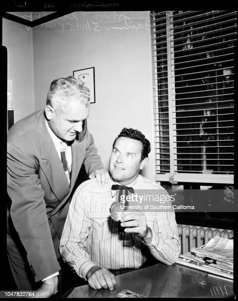 Mickey Finn retires from police department, 10 May 1954. Captain John Kinsling;Mickey Finn.;Caption slip reads: 'Photographer: Glickman. Date: ....