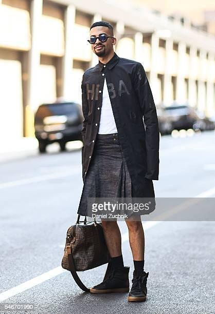 Mickey Freeman is seen outside the Robert Geller show wearing a Hood by Air shirt Free Men by Mickey skirt Kris Van Asche sneakers and a Fendi bag...