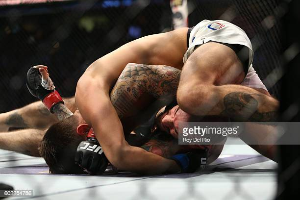 Mickey Gall punches CM Punk during the UFC 203 event at Quicken Loans Arena on September 10 2016 in Cleveland Ohio