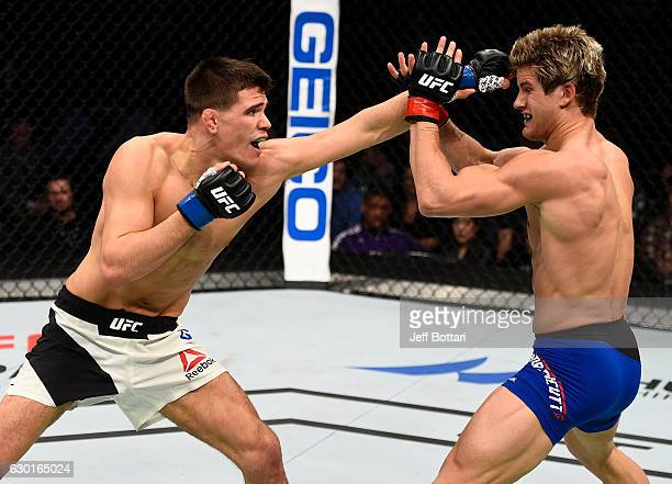 Mickey Gall punches Sage Northcutt in their welterweight bout during the UFC Fight Night event inside the Golden 1 Center Arena on December 17 2016...