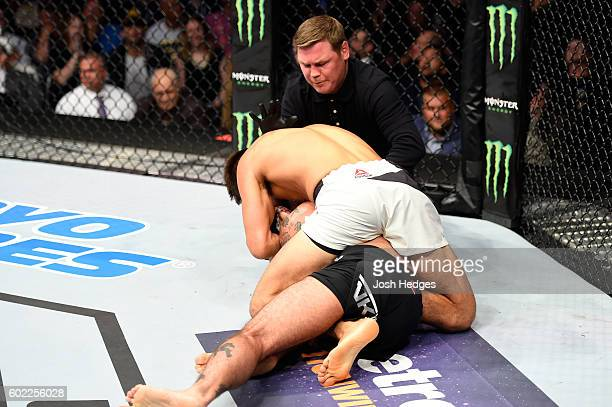Mickey Gall submits Phil 'CM Punk' Brooks in their welterweight bout during the UFC 203 event at Quicken Loans Arena on September 10 2016 in...