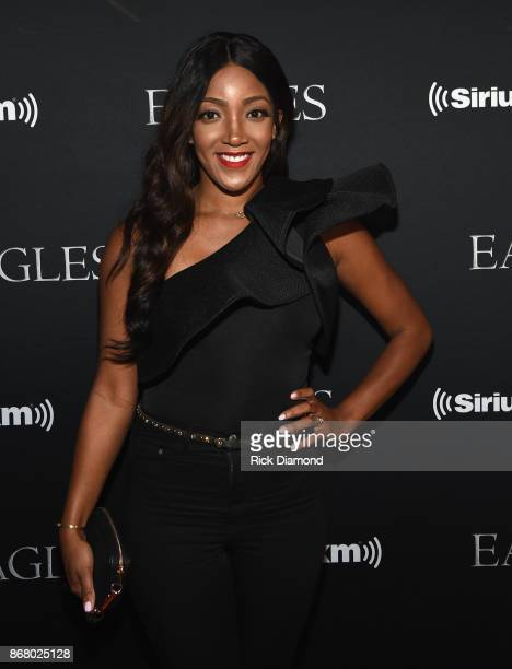 Mickey Guyton attends SiriusXM presents the Eagles in their first ever concert at the Grand Ole Opry House on October 29 2017 in Nashville Tennessee