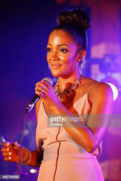 Mickey Guyton performs at Pandora presents Love and Theft at StubHub's Next Stage Series at Cannery Ballroom on June 17 2014 in Nashville Tennessee