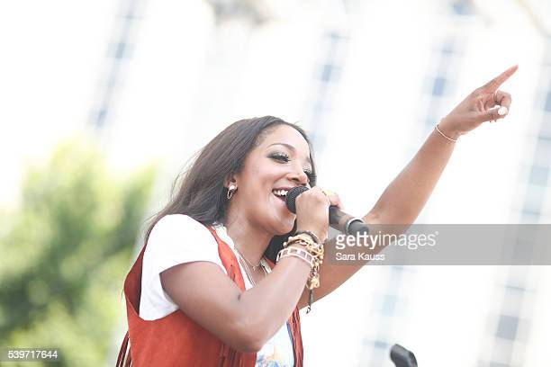 Mickey Guyton performs on the Chevrolet Cruze Park Stage at the 2016 CMA Music Fest on June 12 2016 in Nashville Tennessee