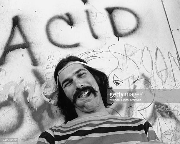 Mickey Hart of the rock and roll band The Grateful Dead poses for a portrait under graffiti that reads Acid on Portrero Hill in circa 1968 in San...