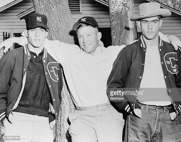 Mickey Mantle is flanked here by his twin brothers Roy left and Ray in front of their Commerce Oklahoma home