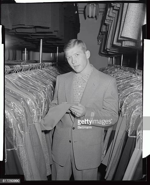 Mickey Mantle New York Yankees' young out fielding star inspects some civilian suits as he shops in New York preparatory to reporting to the spring...