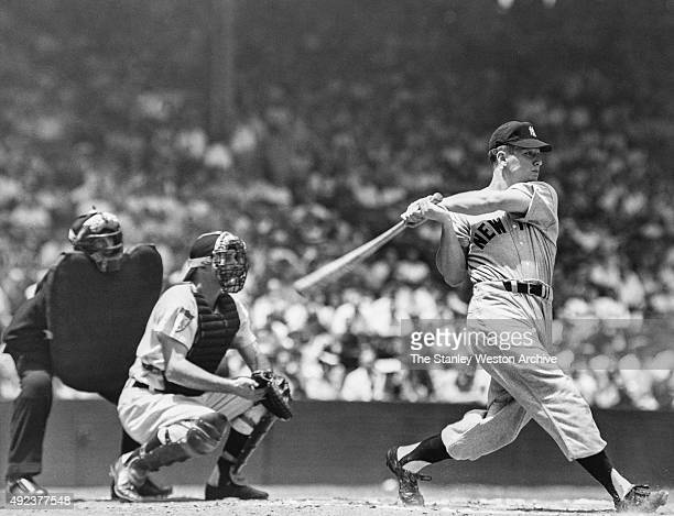 Mickey Mantle of the New York Yankees hits a home run during an MLB game circa 1956