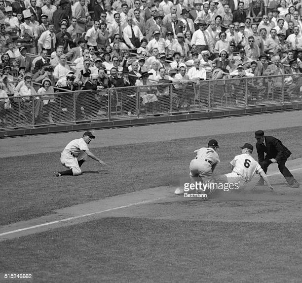 Mickey Mantle of the New York Yankees is out at third on his attempt to advance from first on Booby Brown's single to centerfield in the first inning...