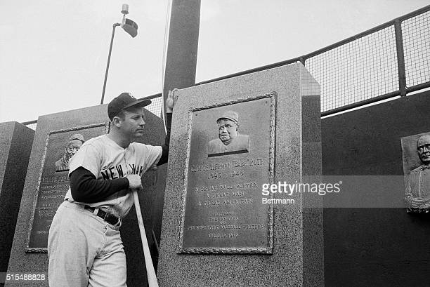 """Mickey Mantle of the New York Yankees looks at the centerfield memorial to the """"Ace"""" of home run hitter, Babe Ruth in Yankee Stadium here on April..."""